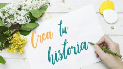 En la imagen aparece una mano escribiendo en un papel el texto: crea tu historia, como parte de la estrategia de Marca Personal